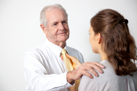 Daughter adjusting tie to father Stock Photo
