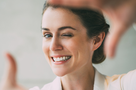 Closeup of Smiling Woman Making Frame Gesture Stock Photo