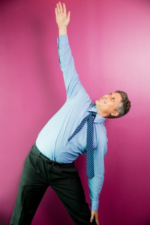 Smiling Middle-aged Business Man Exercising Stock Photo