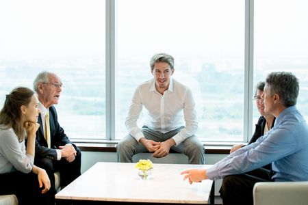 Business Colleagues Discussing Issues in Lounge Stock Photo