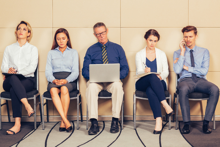 businessman waiting call: Men and Women Sitting and Waiting for Interview