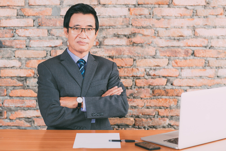 Serious senior businessman in modern office