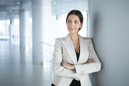 Self-assured Business Woman With Arms Crossed Stock Photo