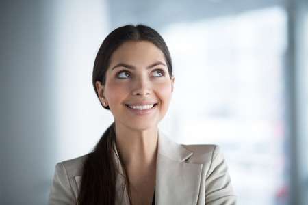Smiling Business Woman Looking up at Copy Space
