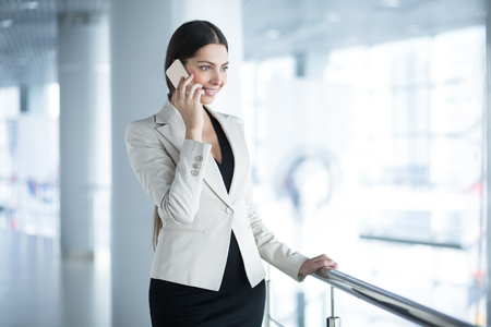 Smiling Elegant Business Woman Calling on Phone