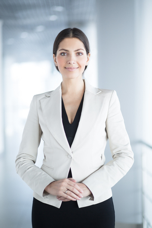 Smiling Elegant Business Woman in Office Hall