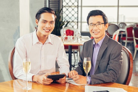 professional flute: Smiling Businessmen with Glasses of Champagne