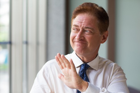 Unpleased mature entrepreneur refusing offer Stock Photo