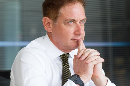 Closeup of Thoughtful Middle-aged Business Man
