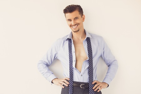 Smiling Young Business Man in Unbuttoned Shirt