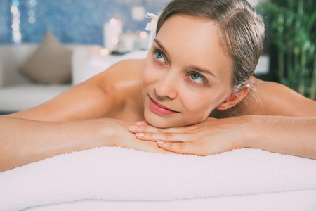 Attractive Woman Lying on Massage Table in Spa