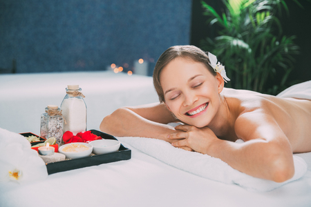 Happy Young Woman Relaxing in Spa Center Stock Photo