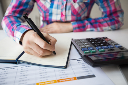 Cropped View of Accountant Making Notes in Diary Stock Photo