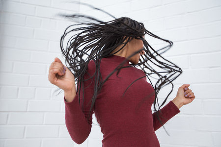 Playful Black Woman Shaking Head With Dreadlocks