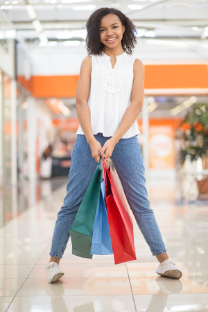 Playful Pretty Black Girl Holding Shopping Bags