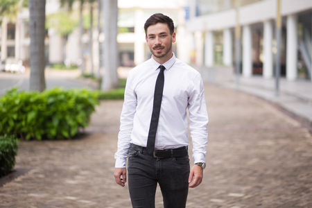Confident young businessman walking over street
