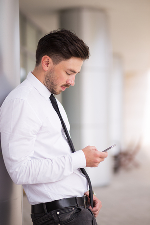 Concentrated manager using Internet on gadget Stock Photo