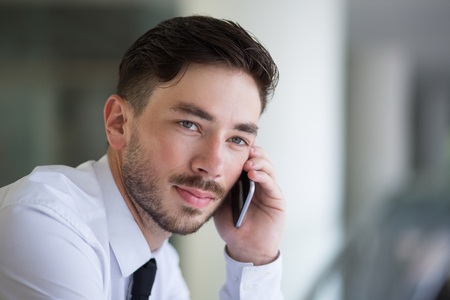 waiting phone call: Thoughtful young manager waiting for answer