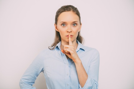 Closeup of Serious Woman Making Silence Gesture