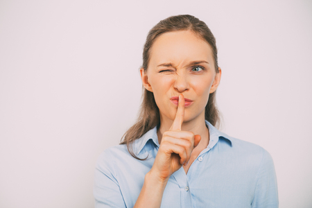 Closeup of Funny Young Woman Winking and Gesturing Stock Photo