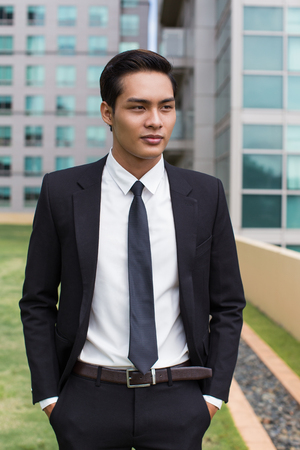 Closeup of Confident Business Man Standing Outside