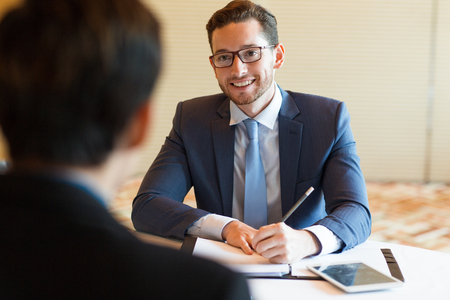 Smiling Manager Interviewing Applicant Stock Photo