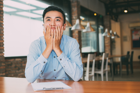 Man Dreaming about Success and Working in Cafe