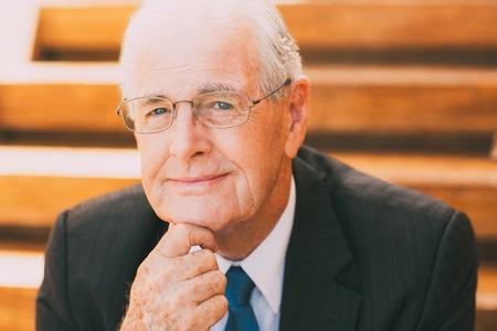 Portrait of Smiling Mature Businessman Stock Photo