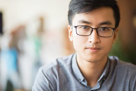 Confident Asian businessman in eyeglasses