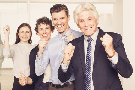 recourse: Successful business team showing yes gestures
