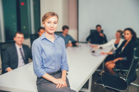 large group of business people: Young Businesswoman in Office