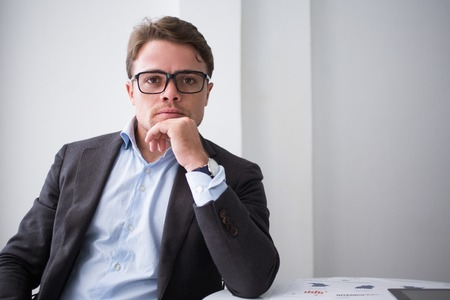 Serious man in eyeglasses confident in himself