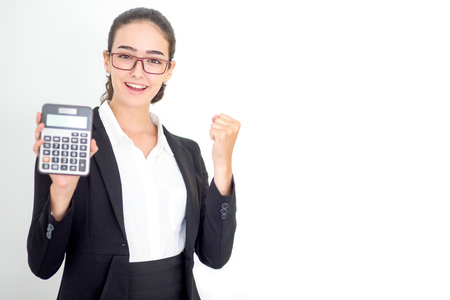 Happy young businesswoman showing winning gesture