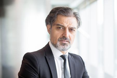 unsatisfied: Confused senior businessman wearing suit