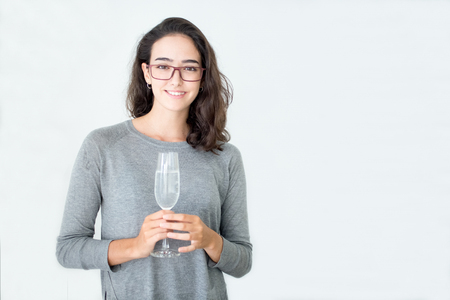 professional flute: Excited young businesswoman drinking champagne