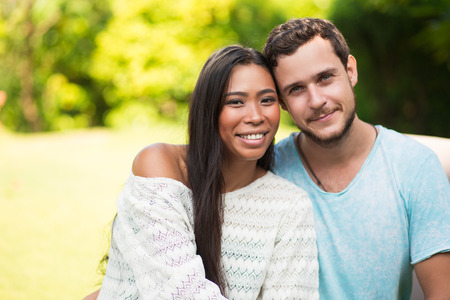 tenderly: Smiling Multi-ethnic Couple Embracing Tenderly Stock Photo