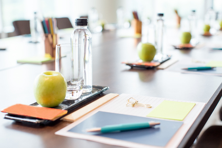 Conference Table With Water and Stationery Foto de archivo