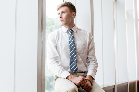 Content Business Leader Looking Through Window Stock Photo