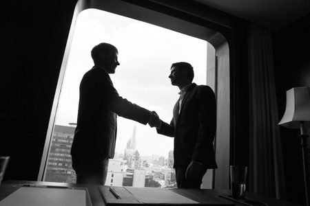 concluding: Business partners concluding new agreement