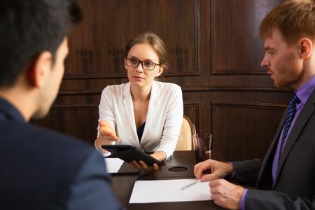 advancing: Serious businesswoman advancing argument Stock Photo