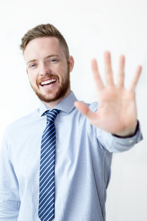 Happy Business Man Showing Stop Gesture
