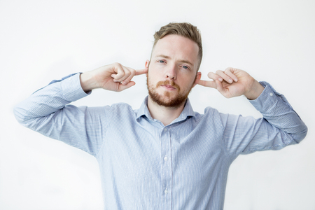 imperturbable: Serious Man Stopping Ears With Fingers