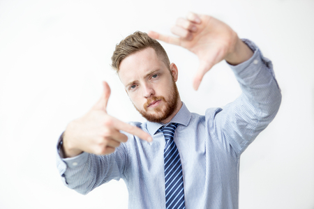 Serious Business Man Making Frame Gesture Stock Photo