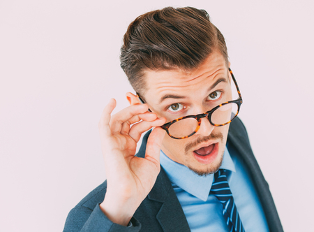 Surprised young businessman posing in eyeglasses Stock Photo