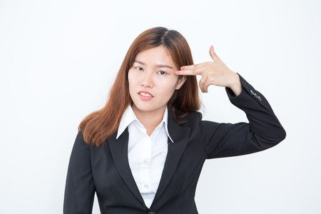 Asian Business Lady Shooting Herself With Fingers Stock Photo