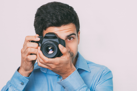 viewfinder: Photographer Looking Through Camera Viewfinder Stock Photo