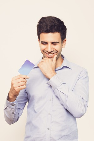 Smiling Young Handsome Man Holding Credit Card Stock Photo