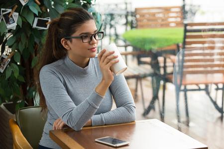 Intelligent businesswoman having coffee break Stock Photo