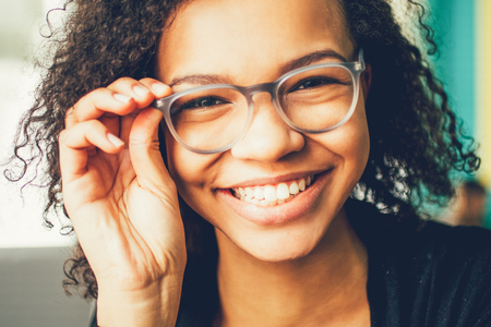 Happy young student or businesswoman in eyeglasses Stock Photo