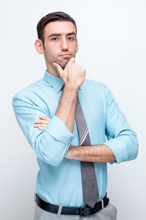 Confident Thoughtful Business Man Touching Chin